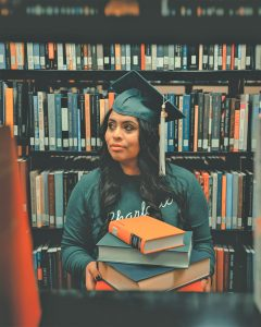 women graduate with books